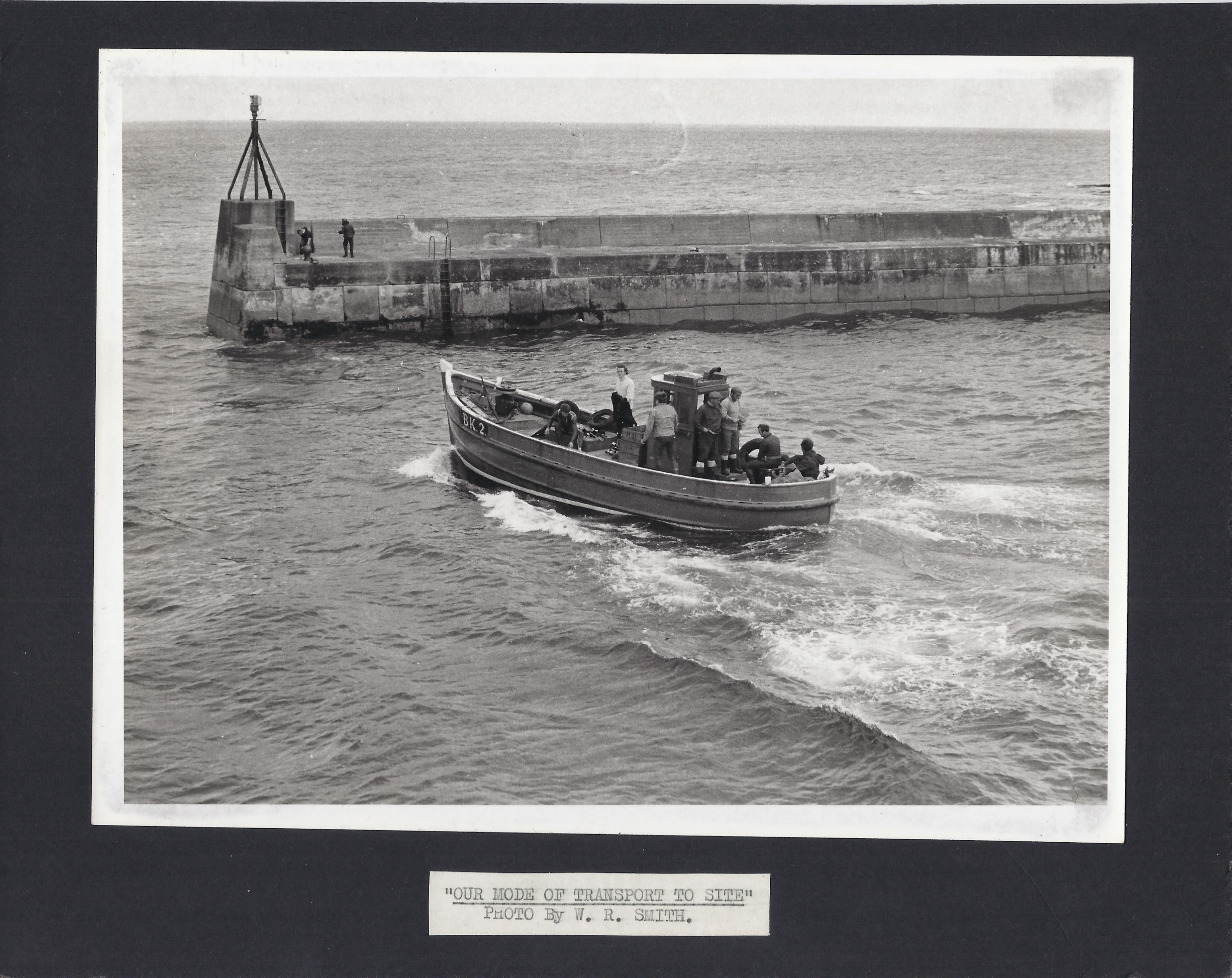 Boat leaving the Seahouses Harbour.