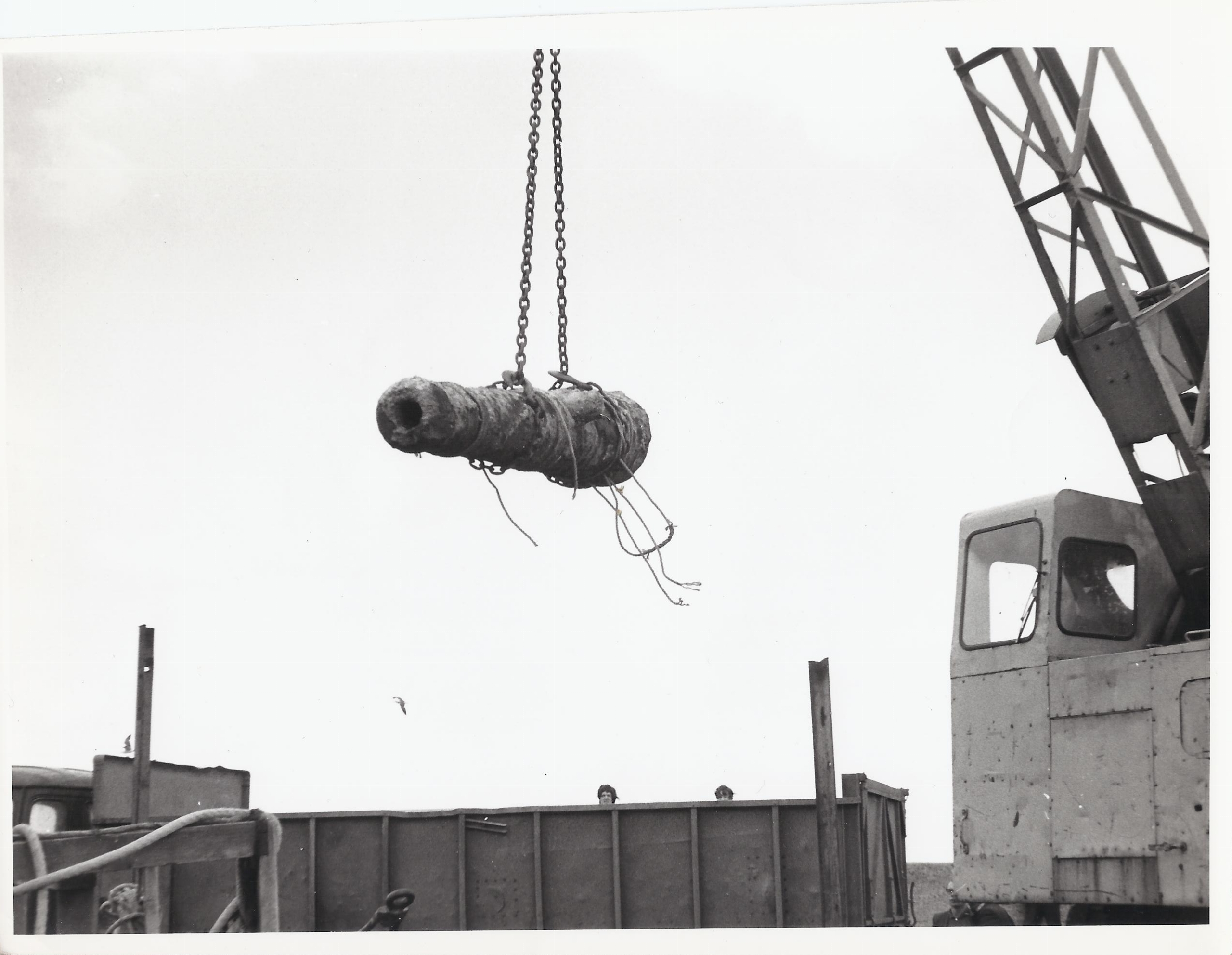 The cannon being lifted